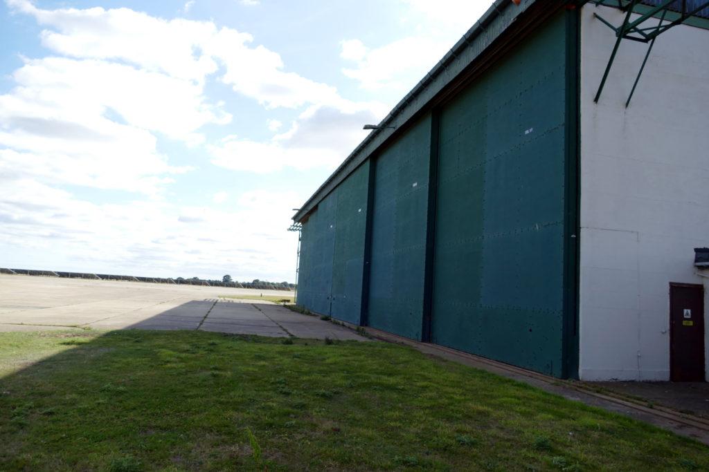 Exterior of original RAF aircraft hangar with large green wall