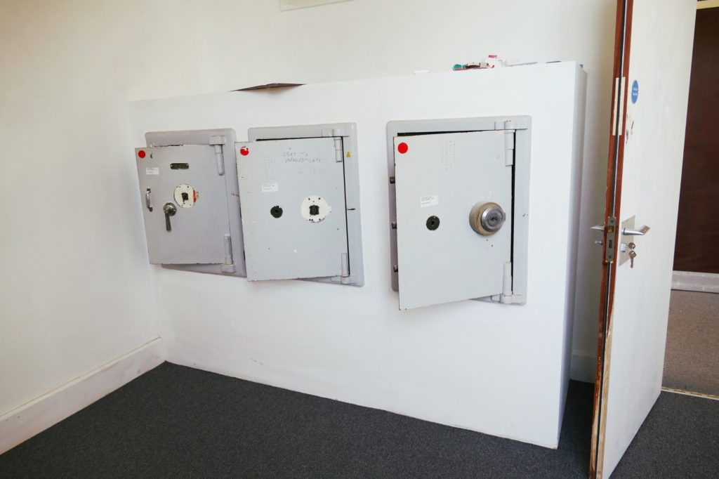 Old RAF grey safes mounted into white wall
